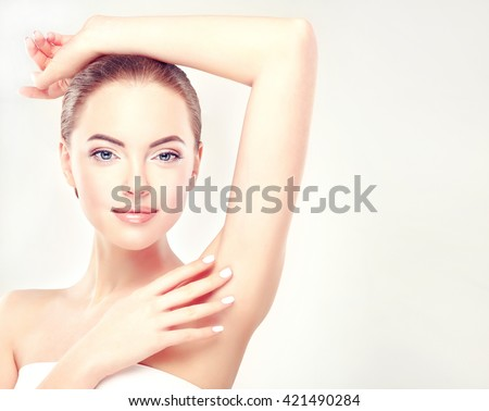 Armpit epilation, lacer hair removal. Young woman holding her arms up and showing clean underarms, depilation  smooth clear skin .Beauty portrait. - stock photo
