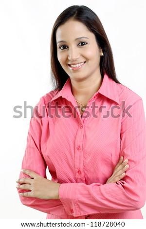 Arms crossed business woman against white