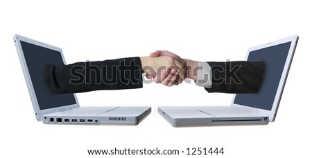Arms reaching from laptop screens to shake hands in a conceptual shot representing connections and networking. - stock photo
