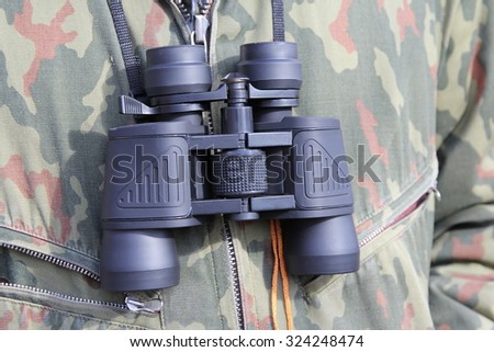 Army and people concept, black binocular hanging on his chest military officer. - stock photo