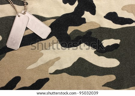 Army badges on camouflage background - stock photo