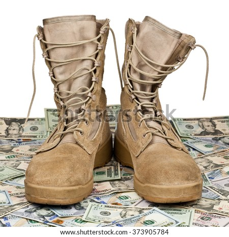 army boots on the background of dollar bills - stock photo