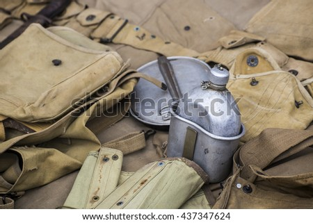 Army equipment laying on the ground . - stock photo
