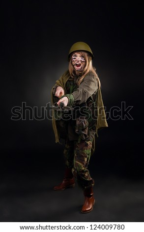 army girl attack shovel, soldier woman in a military uniform full length over black background