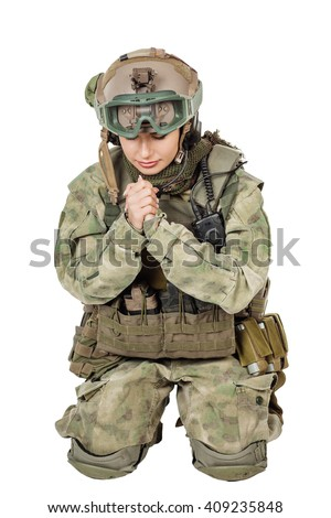 army girl pray closed eyes clasp hands palms, soldier woman in a military uniform over white background - stock photo