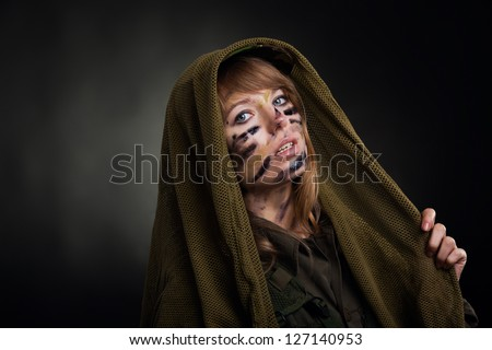 army girl, soldier woman cover by masking net military uniform over black background