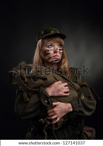 army girl, soldier woman hold backpack military uniform over black background