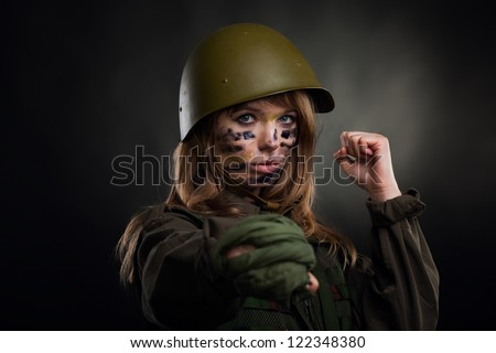 army girl, soldier woman hold fist kick, wear helmet military uniform over black background