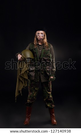 army girl, soldier woman in a military uniform full length over black background