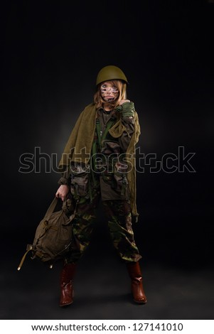 army girl, soldier woman in a military uniform full length over black ...