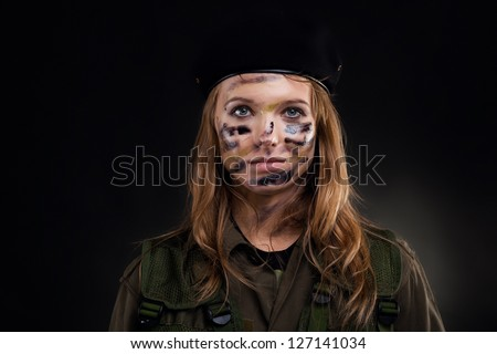 army girl, soldier woman wear berret military uniform over black background