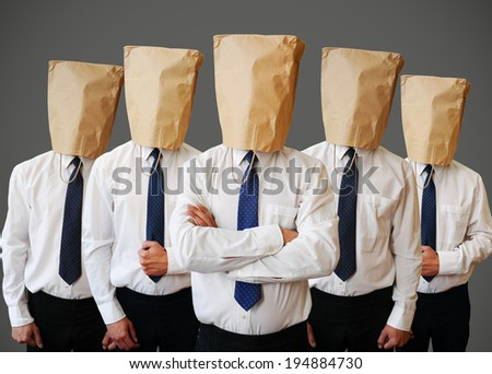army of businessman with a paper bag on head - stock photo