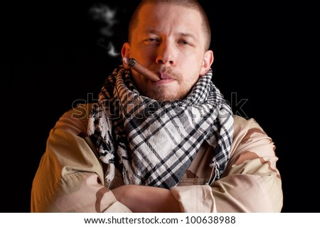 Army officer smoking the victory cigar, over black background