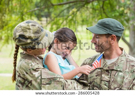 Army parents reunited with their daughter on a sunny day - stock photo
