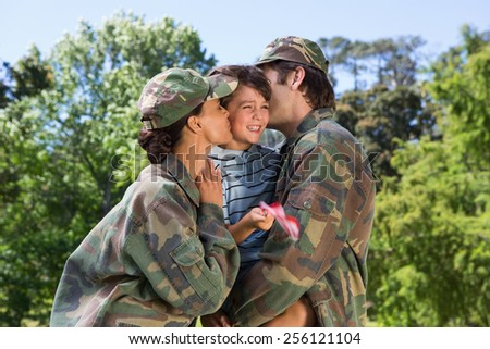 Army parents reunited with their son on a sunny day - stock photo