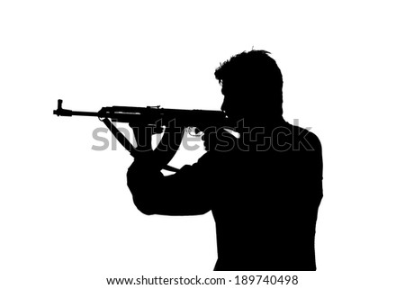 Army soldier/gangster  man shooting on studio isolated on white background - stock photo