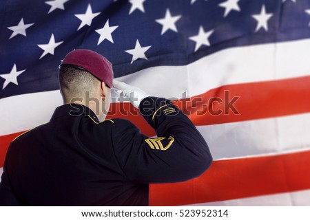 Army soldier saluting American Flag