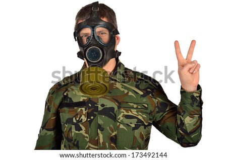 Army Soldier with A Gas Mask Peace gesture - stock photo