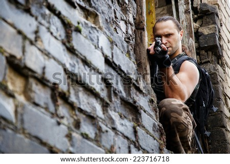 Army soldier with a gun - stock photo