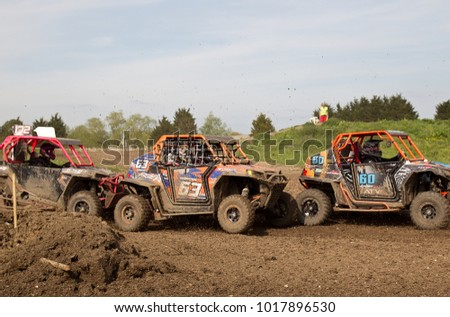 ARNCOTT, UK - MAY 4: Unnamed drivers competing in the UK SXS RZR series reach the first tight corner after the start line resulting in some near misses on the turn on May 4, 2014 in Arncott