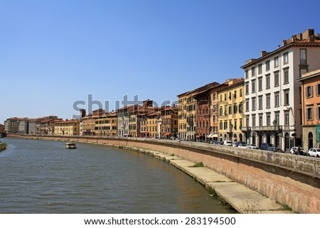Arno river bank in Pisa in Italy - stock photo