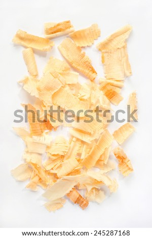 arolla pine wood chippings isolated over white background - stock photo