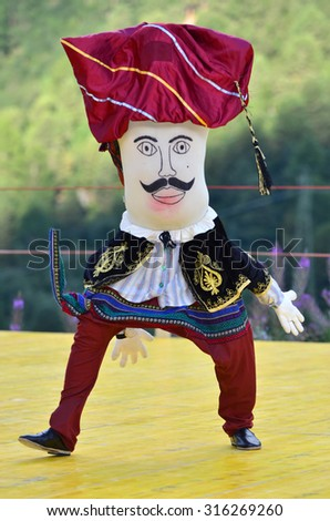 AROLLA, SWITZERLAND - AUGUST 12: Funny dancing doll from Bozdaglar in the CIME mountain culture Festival: August 12, 2015 in Arolla, Switzerland - stock photo