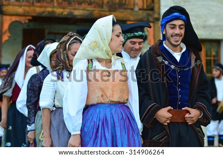 AROLLA, SWITZERLAND - AUGUST 12: Italian dancers in traditional costume from Sardinia in the CIME mountain culture Festival: August 12, 2015 in Arolla, Switzerland - stock photo