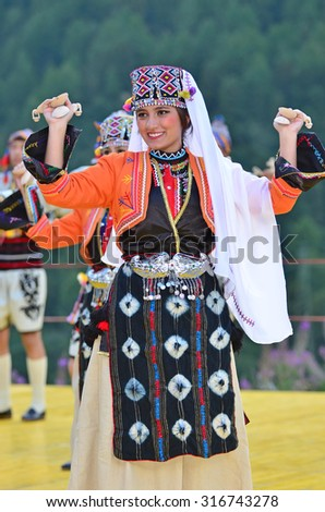 AROLLA, SWITZERLAND - AUGUST 12: Turkish dancing girl from Bozdaglar in the CIME mountain culture Festival: August 12, 2015 in Arolla, Switzerland - stock photo