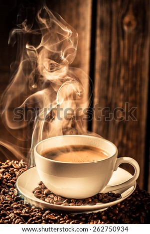 Aroma coffee cup with roasted seeds - stock photo