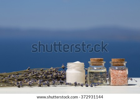 Aroma oils in bottles, cream and salt with lavender - stock photo