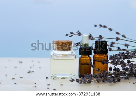 Aroma oils in bottles with lavender - stock photo
