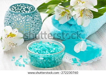 Aroma SPA set with sea salt, natural soap, soft towel and flower on wooden background  - stock photo