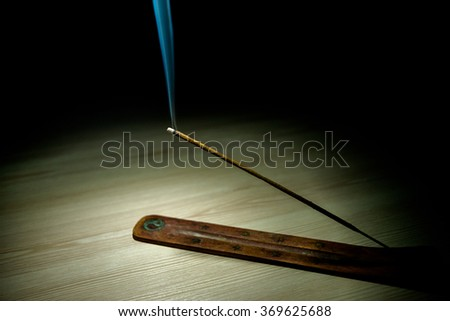 aroma stick on the table in the dark