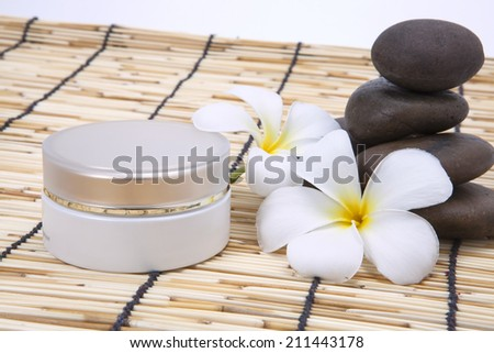 Aromatherapy and spa massage on tropical bamboo and polished stones .