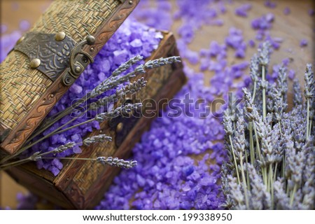 Aromatherapy: Bath salt with wild lavender in vintage wooden box  - stock photo
