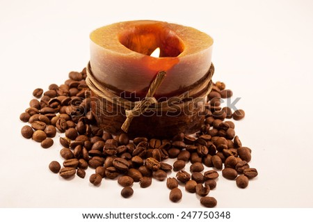 aromatherapy candle with coffee on white background - stock photo