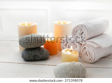 Aromatherapy. Candles and spa objects on the table - stock photo