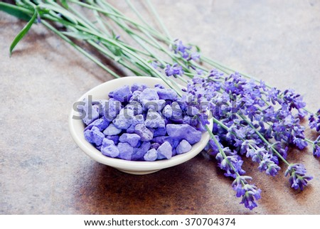 Aromatherapy lavender, lavender spa, Wellness with lavender, lavender Scented stones  on a wooden background - stock photo