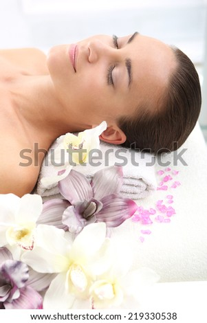 Aromatherapy massage .Woman relaxes in a beauty salon. - stock photo