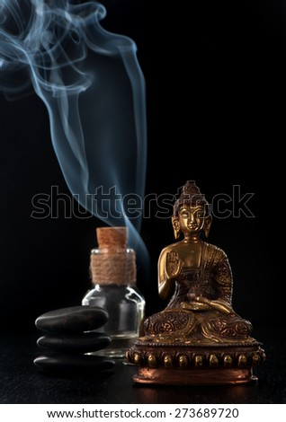 Aromatherapy, meditation and spa. Buddha statue, essential oil and stones zen - stock photo