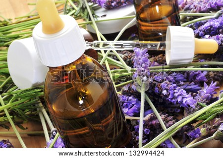 aromatherapy oil and lavender flowers - stock photo