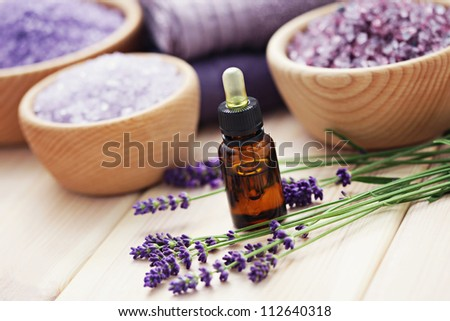 aromatherapy oil andbowl of lavender bath salt - beauty treatment - stock photo
