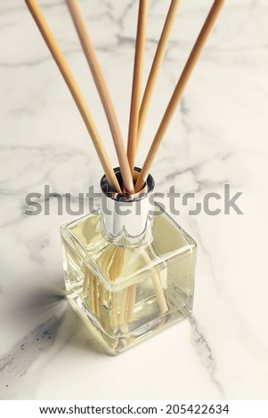 Aromatherapy reed diffuser air freshener on marble background - stock photo