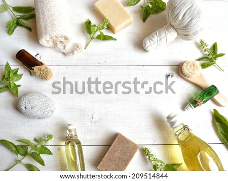 Aromatherapy supplies with basil leaves - stock photo