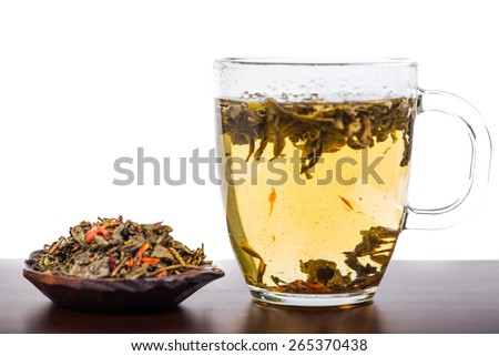 Aromatic antioxidant green tea on wooden board, isolated background - stock photo