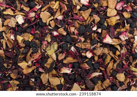 aromatic black dry tea with fruits and petals, isolated on white - stock photo