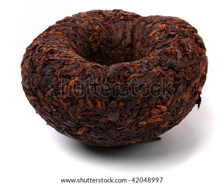 Aromatic black pu-erh tea from yunnan province in China. Leaves undergoes double fermentation and convex knob-shaped. Healthy hot drink, natural anti-biotic medicine. - stock photo