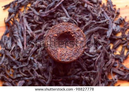 Aromatic black pu-erh tea from yunnan province in China. Leaves undergoes double fermentation and compressed into bricks. Healthy drink. - stock photo