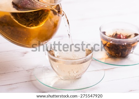 Aromatic Blooming Flower Tea in glass cup - stock photo